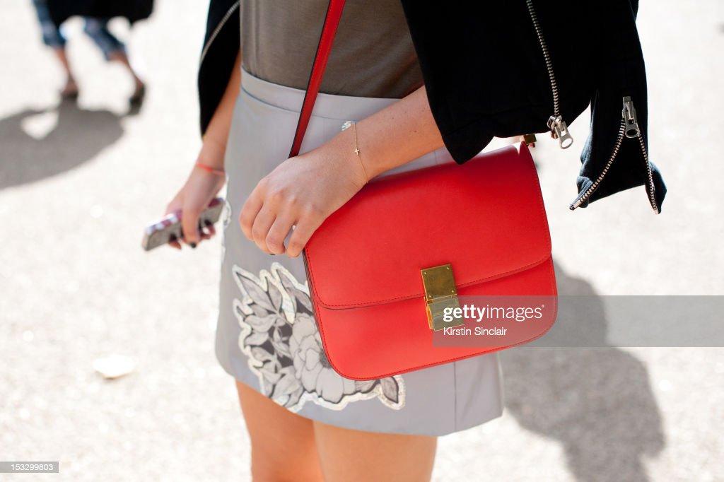 Natalie Sytner Pr for Browns, wearing a Christopher Kane skirt, Celine bag, Black Denim t shirt, Sandro jacket on day 5 of London Fashion Week Spring/Summer 2013, on September 18, 2012 in London, England.