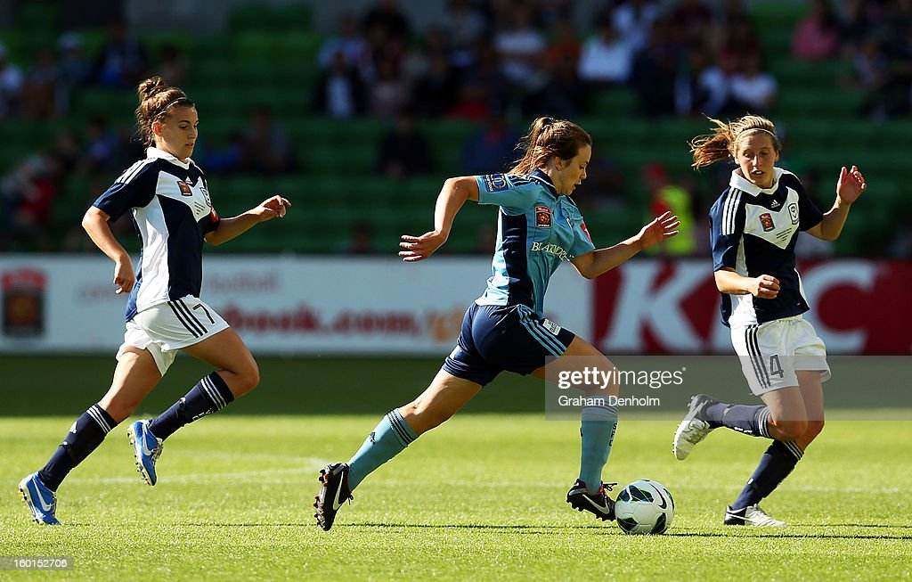 Natalie Tobin of Sydney FC (C) runs with the ball under pressure from the Victory defence during the W-League Grand Final between the Melbourne Victory and Sydney FC at AAMI Park on January 27, 2013 in Melbourne, Australia.