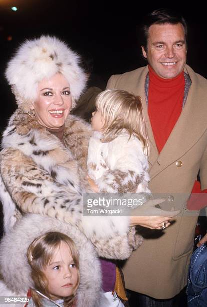 Natalie Wood and Robert Wagner with their children at the Hollywood Christmas Parade on December 19 1976 in Los Angeles California