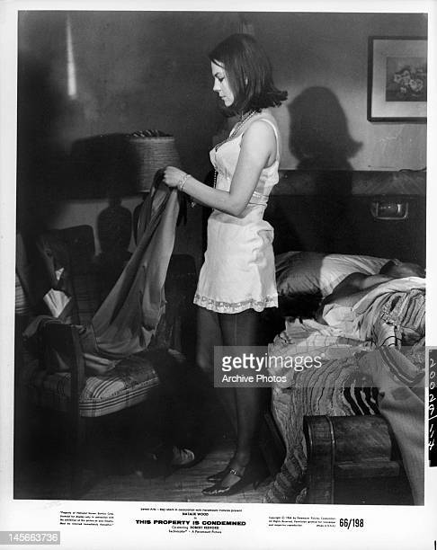 Natalie Wood getting dressed in a scene from the film 'This Property Is Condemned' 1966
