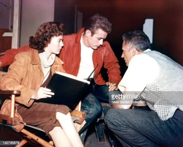 Natalie Wood US actress James Dean US actor and Nicholas Ray US film director on the set of 'Rebel Without a Cause' USA 1955 The drama directed by...