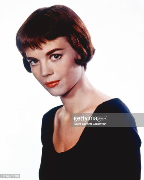 Natalie Wood US actress wearing a black top with a round neckline in a studio portrait against a white background circa 1965