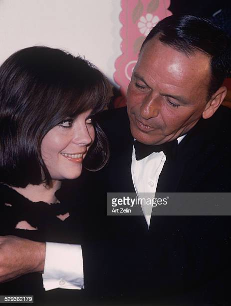 Natalie Wood with Frank Sinatra in a tuxedo giving her a hug circa 1970 New York