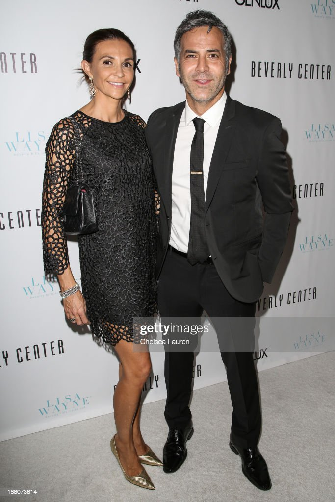 Natalie Zapata (L) and Guillermo Zapata arrive at the Genlux new issue launch party hosted by Lisa Vanderpump on November 14, 2013 in Beverly Hills, California.