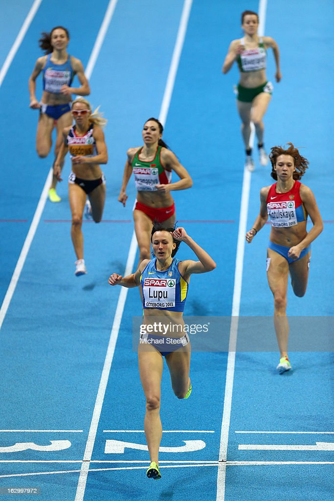 Nataliya Lupu of Ukraine crosses the line ahead of Elena Kotulskaia of Russia to win gold in the Men's 800m Final during day three of European Indoor Athletics at Scandinavium on March 3, 2013 in Gothenburg, Sweden.