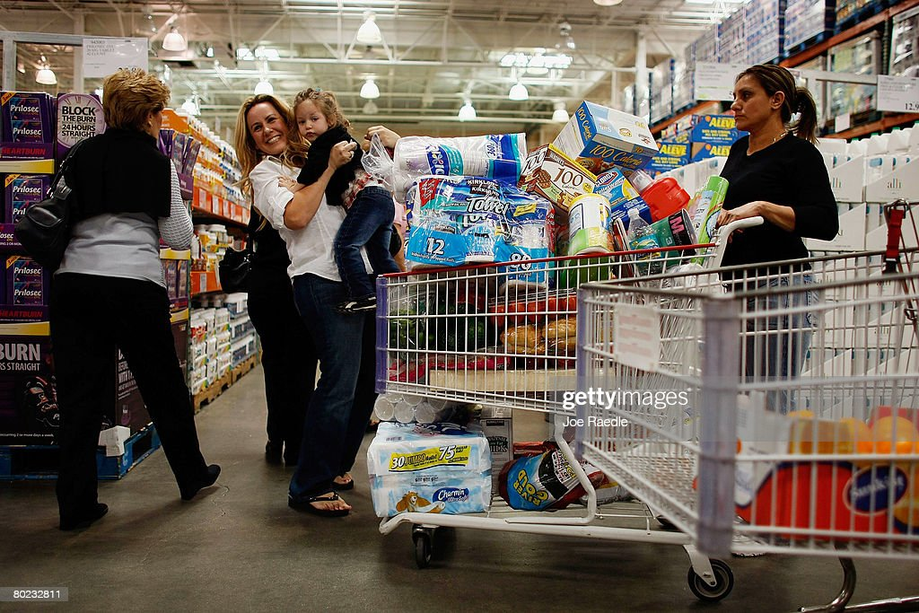 Nataly Gold Sivan Gold and Anna Rodriguez and others shop at a Costco store March 13 2008 in North Miami FloridaThe Commerce Department released a...