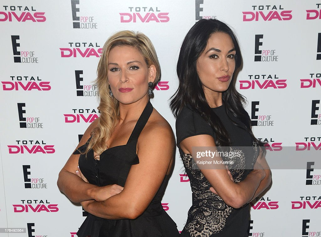 Natalya and Nikki Bella arrive to the WWE SummerSlam press Conference at Beverly Hills Hotel on August 13, 2013 in Beverly Hills, California.