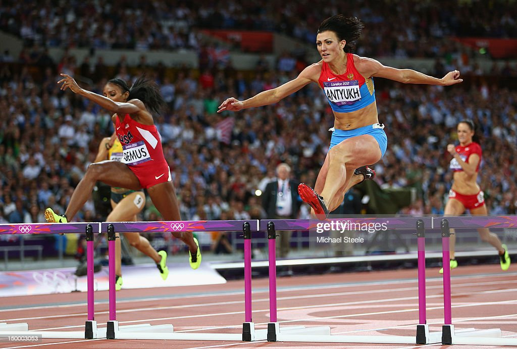 Natalya Antyukh of Russia crosses the finish line ahead of Lashinda Demus of the United States in the Women's 400m Hurdles Final on Day 12 of the London 2012 Olympic Games at Olympic Stadium on August 8, 2012 in London, England.
