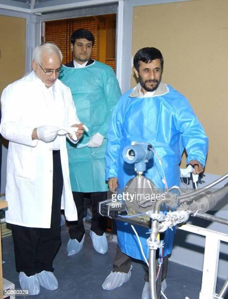 Iranian President Mahmoud Ahmadinejad and Gholamreza Aghazadeh head of Iran's Atomic Energy Organisation visit the Natanz uranium enrichment...