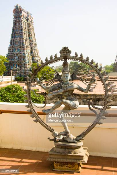 Nataraja, dancing posture of Hindu God Shiva, and a gopuram, Meenakshi Temple, Madurai, Tamil Nadu, India