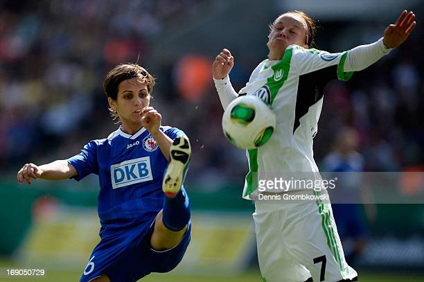 Natasa Andonova of Potsdam and Viola Odebrecht of Wolfsburg battle for the ball during the Women's DFB Cup Final between VfL Wolfsburg and 1 FFC...
