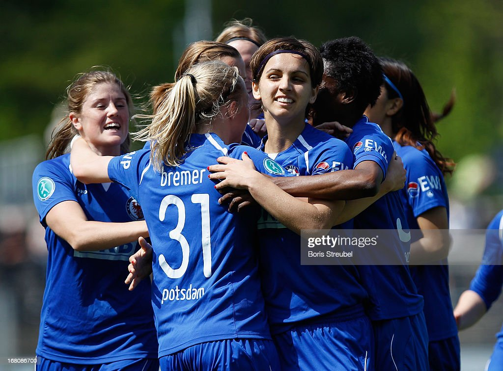 Natasa Andonova of Potsdam (center R) celebrates with team-mates after scoring their team's first goal during the Women's Bundesliga match between 1. FFC Turbine Potsdam and VfL Wolfsburg on May 5, 2013 in Potsdam, Germany.
