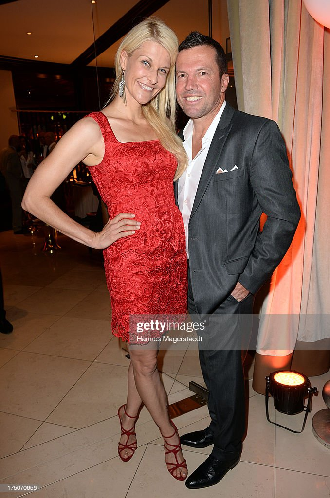Natascha Gruen and Lothar Matthaeus attend the Sommerfest Eclat Dore at Hotel Vier Jahreszeiten on July 30, 2013 in Munich, Germany.
