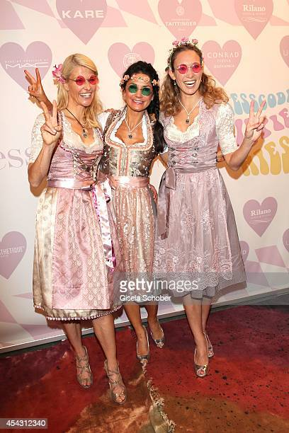 Natascha Gruen Mariella Ahrens Christine Theiss attend the Dresscoded Hippie Wiesn 2014 at Golfclub Gut Thailing on August 28 2014 in Steinhoering...