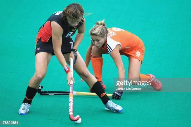 Natascha Keller of Germany battles with Wieke Dijkstra of Netherlands during the women's Final match between Netherlands and Germany on day eight of...