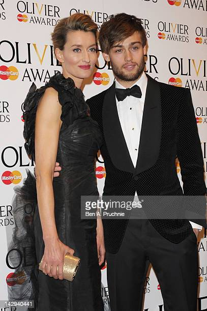 Natascha McElhone and Douglas Booth pose in the press room during the 2012 Olivier Awards at The Royal Opera House on April 15 2012 in London England