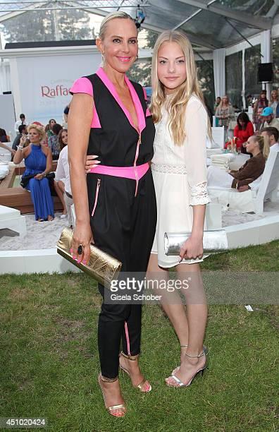 Natascha Ochsenknecht and her daughter Cheyenne Ochsenknecht attend the Raffaello Summer Day 2014 at Kronprinzenpalais on June 21 2014 in Berlin...