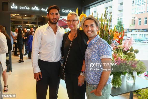 Natascha Ochsenknecht with partner Umut Kekilli and Kian ShamsDolatabad attend the 'Kians Garden Flower Shop' Opening Event at Kantstrasse on July 11...