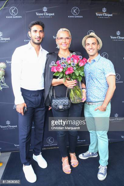 Natascha Ochsenknecht with partner Umut Kekilli and Kian ShamsDolatabadi attend the 'Kians Garden Flower Shop' Opening Event at Kantstrasse on July...