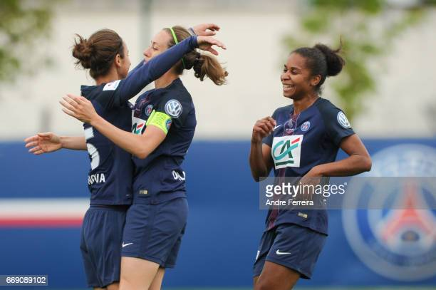 Natasha Andonova of PSG celebrates her goal with Sabrina Delannoy of PSG and Laura Georges of PSG during the women's National Cup match between Paris...