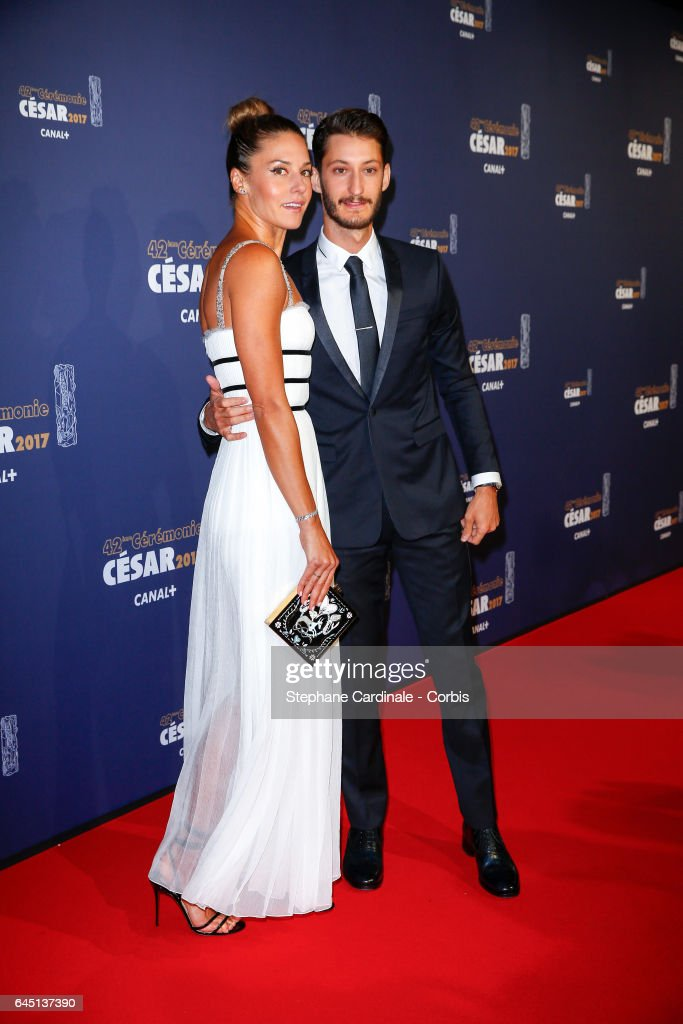 Natasha Andrews and Pierre Niney arrive at the Cesar Film Awards 2017 ceremony at Salle Pleyel on February 24, 2017 in Paris, France.