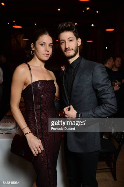 Natasha Andrews and Pierre Niney attend the Dior Homme Menswear Aftershow Cocktail Dinner Fall/Winter 20172018 show as part of Paris Fashion Week on...