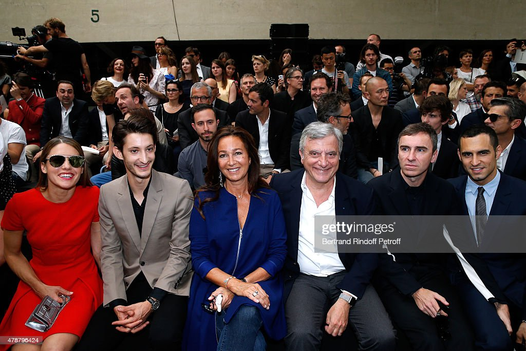 Natasha Andrews, Pierre Niney, Katia Toledano, her husband CEO Dior Sidney Toledano, Fashion Designer Raf Simons and Guest attend the Dior Homme Menswear Spring/Summer 2016 show as part of Paris Fashion Week on June 27, 2015 in Paris, France.