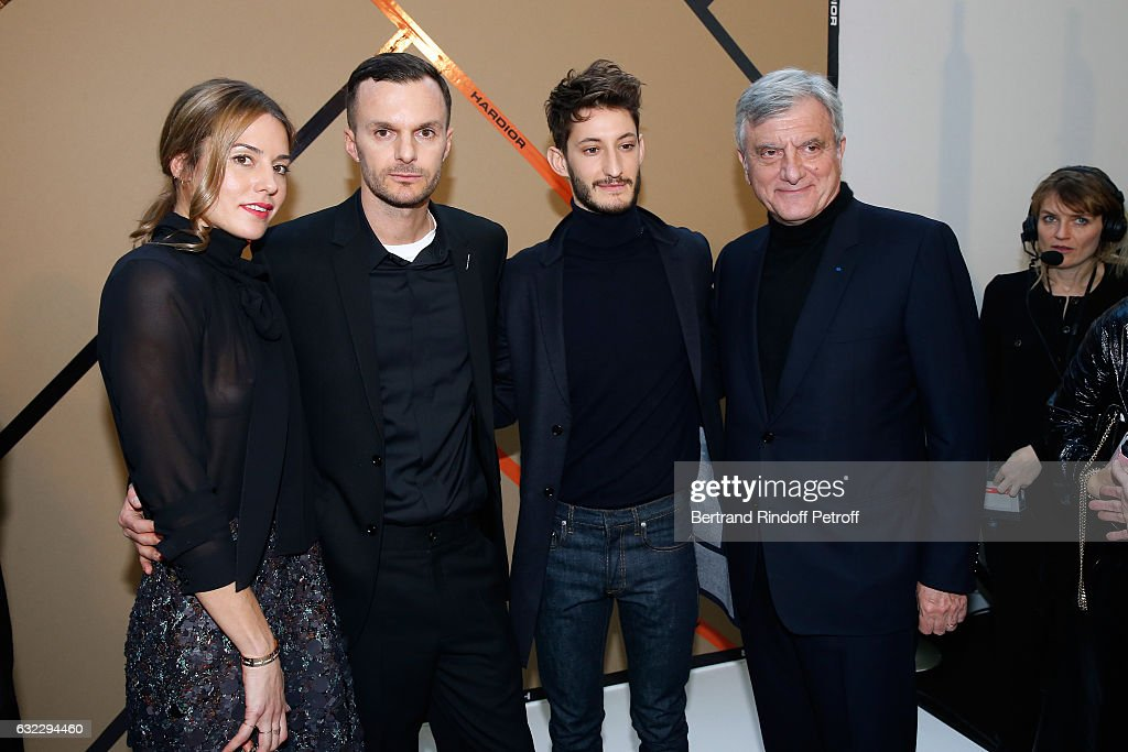 Natasha Andrews, Stylist Kris Van Assche, Pierre Niney and CEO Dior Sidney Toledano pose backstage after the Dior Homme Menswear Fall/Winter 2017-2018 show as part of Paris Fashion Week on January 21, 2017 in Paris, France.