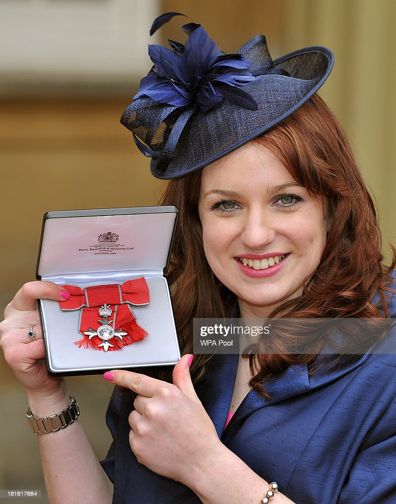 Natasha Baker holds her Member of the British Empire (MBE) medal after it was presented to her by Queen Elizabeth II at the Investiture Ceremony at Buckingham Palace on February 13, 2012 in London, England.