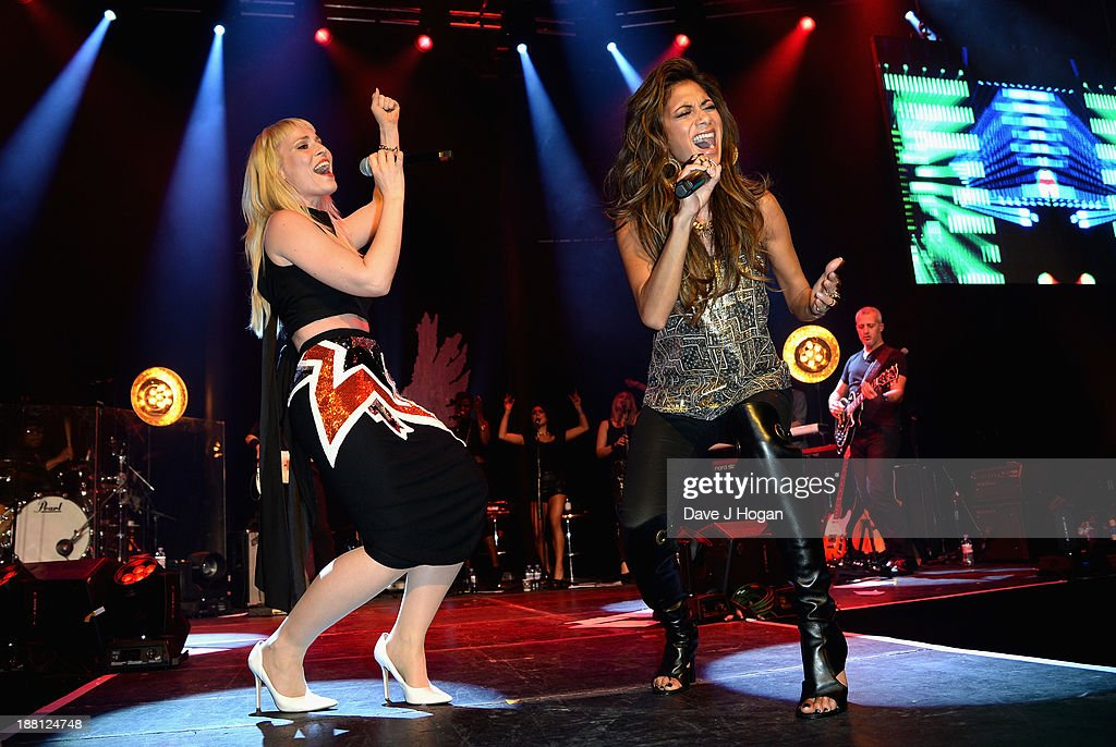 <a gi-track='captionPersonalityLinkClicked' href=/galleries/search?phrase=Natasha+Bedingfield&family=editorial&specificpeople=171728 ng-click='$event.stopPropagation()'>Natasha Bedingfield</a> and <a gi-track='captionPersonalityLinkClicked' href=/galleries/search?phrase=Nicole+Scherzinger&family=editorial&specificpeople=678971 ng-click='$event.stopPropagation()'>Nicole Scherzinger</a> perform onstage at The Global Angel Awards at the Roundhouse on November 15, 2013 in London, England.