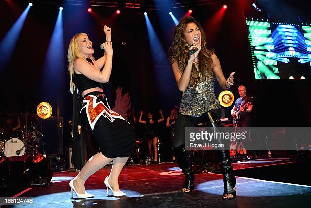 Natasha Bedingfield and Nicole Scherzinger perform onstage at The Global Angel Awards at the Roundhouse on November 15 2013 in London England
