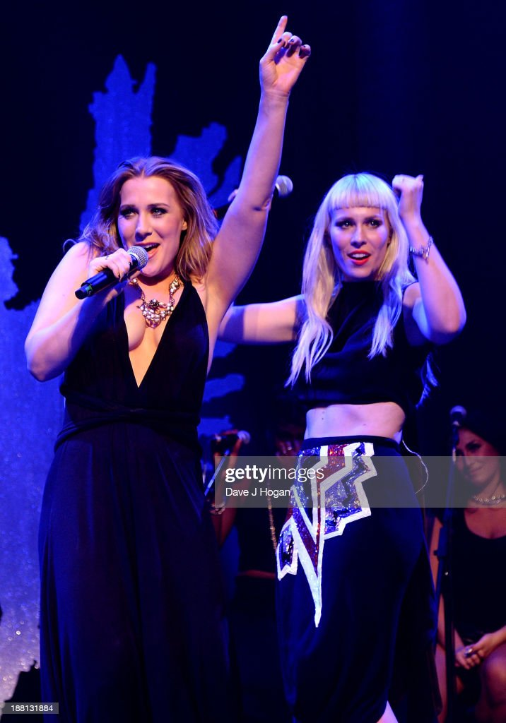 <a gi-track='captionPersonalityLinkClicked' href=/galleries/search?phrase=Natasha+Bedingfield&family=editorial&specificpeople=171728 ng-click='$event.stopPropagation()'>Natasha Bedingfield</a> (R) performs onstage with her sister Nikola Rachelle during The Global Angel Awards at the Roundhouse on November 15, 2013 in London, England.