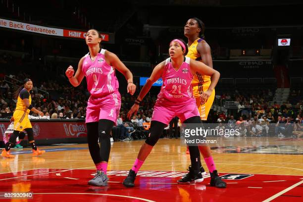 Natasha Cloud and Tianna Hawkins of the Washington Mystics play defense against Jantel Lavender of the Los Angeles Sparks on August 16 2017 at the...