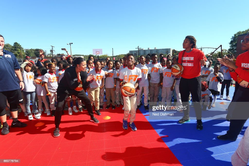 Natasha Cloud and Tierra Ruffin-Pratt of the Washington Mystics participates in a clinic at Hendley Elementary school during a court dedication and WNBA Fit Clinic on October 17, 2017 at Hendley Elementary school in Washington, DC.