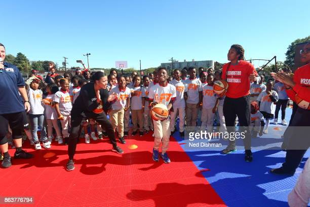 Natasha Cloud and Tierra RuffinPratt of the Washington Mystics participates in a clinic at Hendley Elementary school during a court dedication and...