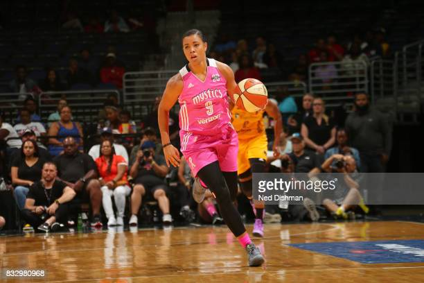 Natasha Cloud of the Washington Mystics brings the ball up court against the Los Angeles Sparks on August 16 2017 at the Verizon Center in Washington...
