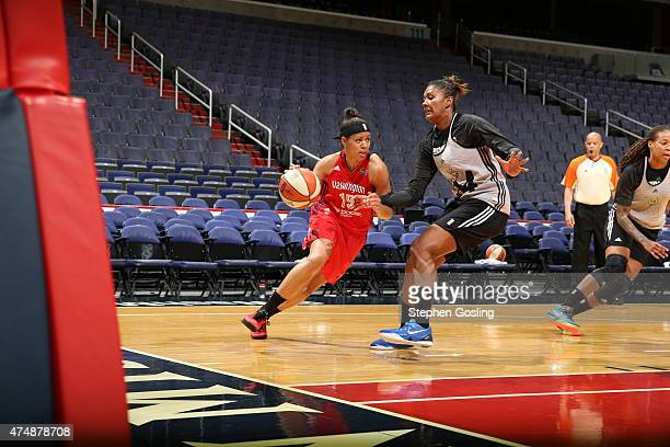 Natasha Cloud of the Washington Mystics drives against Devereaux Peters of the Minnesota Lynx during an Analytic Scrimmage at the Verizon Center on...