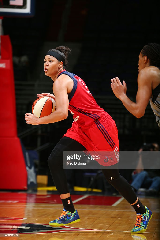 <a gi-track='captionPersonalityLinkClicked' href=/galleries/search?phrase=Natasha+Cloud&family=editorial&specificpeople=7418023 ng-click='$event.stopPropagation()'>Natasha Cloud</a> #15 of the Washington Mystics drives to the basket against the San Antonio Stars on June 29, 2016 at the Verizon Center in Washington, DC.