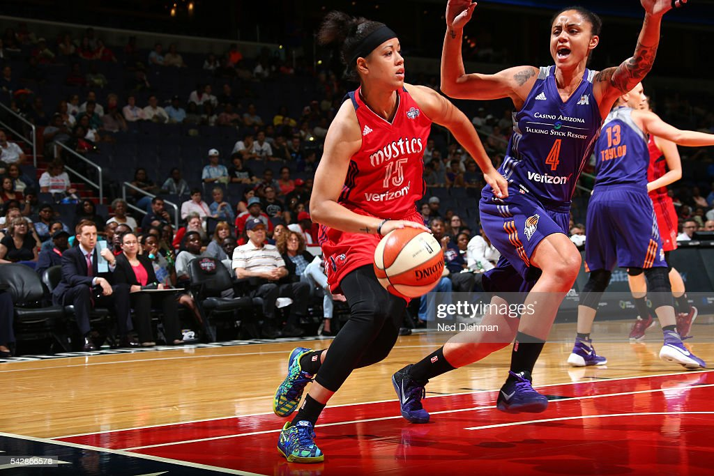 <a gi-track='captionPersonalityLinkClicked' href=/galleries/search?phrase=Natasha+Cloud&family=editorial&specificpeople=7418023 ng-click='$event.stopPropagation()'>Natasha Cloud</a> #15 of the Washington Mystics drives to the basket during the game against <a gi-track='captionPersonalityLinkClicked' href=/galleries/search?phrase=Candice+Dupree&family=editorial&specificpeople=537818 ng-click='$event.stopPropagation()'>Candice Dupree</a> #4 of the Phoenix Mercury during a WNBA game on June 24, 2016 at Verizon Center in Washington, DC.