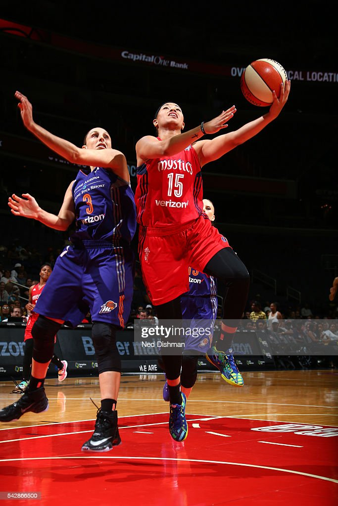 <a gi-track='captionPersonalityLinkClicked' href=/galleries/search?phrase=Natasha+Cloud&family=editorial&specificpeople=7418023 ng-click='$event.stopPropagation()'>Natasha Cloud</a> #15 of the Washington Mystics goes for a lay up during the game against <a gi-track='captionPersonalityLinkClicked' href=/galleries/search?phrase=Diana+Taurasi&family=editorial&specificpeople=202558 ng-click='$event.stopPropagation()'>Diana Taurasi</a> #3 of the Phoenix Mercury during a WNBA game on June 24, 2016 at Verizon Center in Washington, DC.
