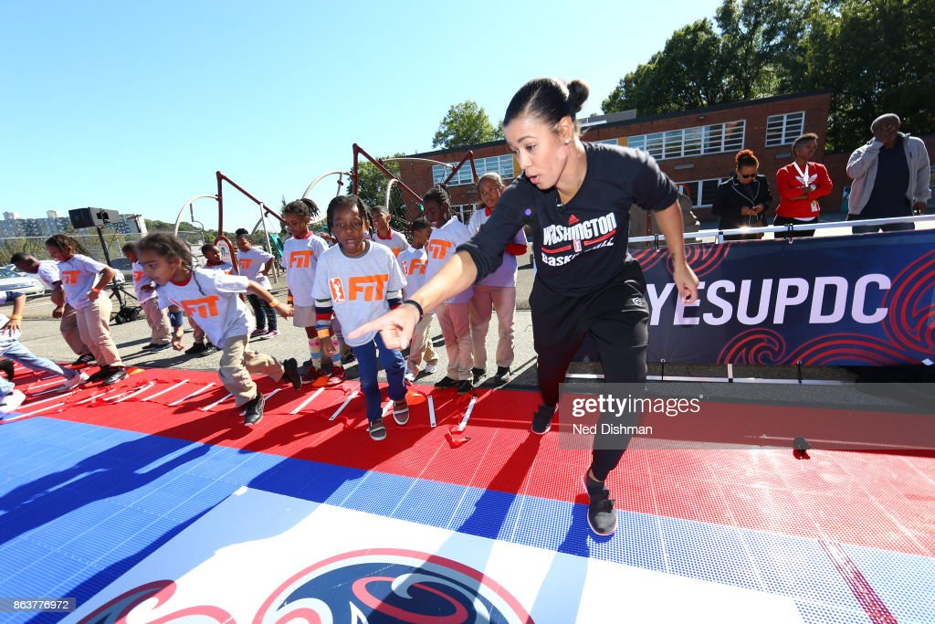 Natasha Cloud of the Washington Mystics participates in a clinic at Hendley Elementary school during a court dedication and WNBA Fit Clinic on October 17, 2017 at Hendley Elementary school in Washington, DC.