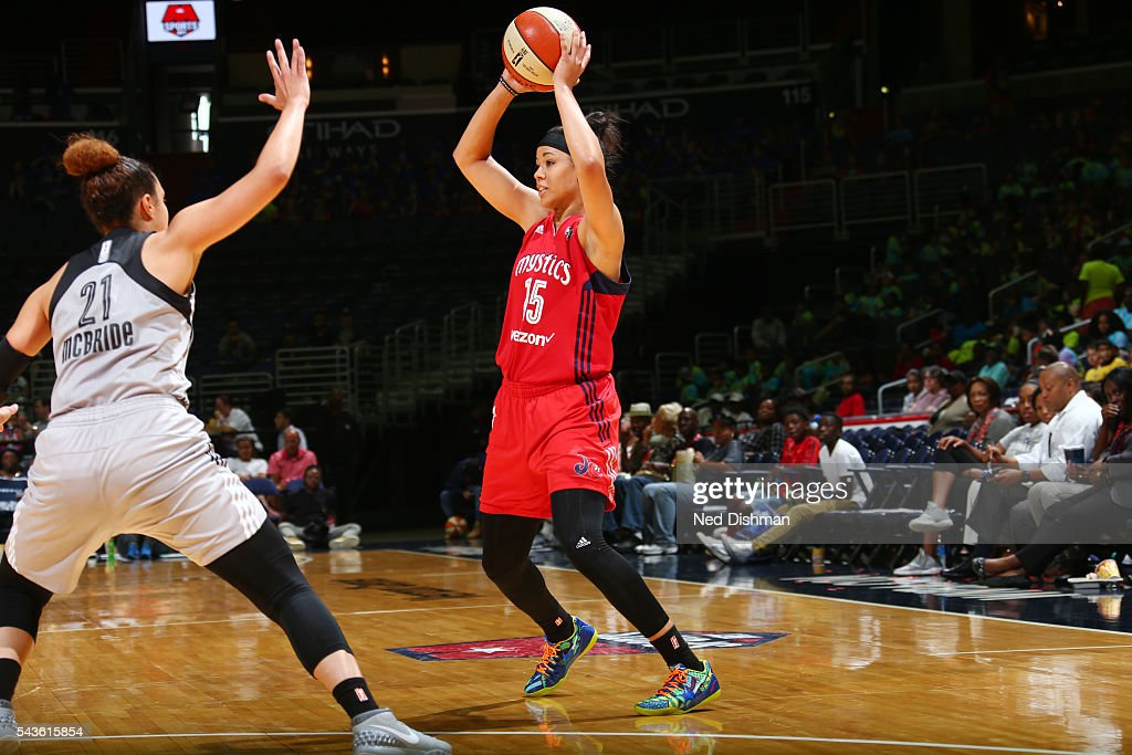 <a gi-track='captionPersonalityLinkClicked' href=/galleries/search?phrase=Natasha+Cloud&family=editorial&specificpeople=7418023 ng-click='$event.stopPropagation()'>Natasha Cloud</a> #15 of the Washington Mystics passes the ball against the San Antonio Stars on June 29, 2016 at the Verizon Center in Washington, DC.