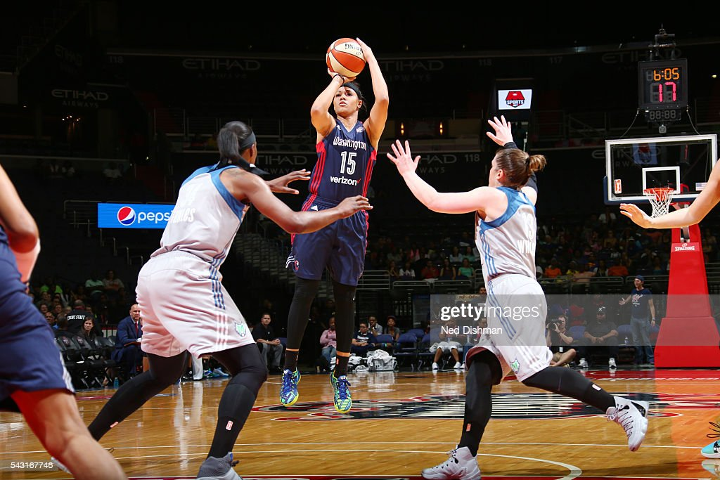 <a gi-track='captionPersonalityLinkClicked' href=/galleries/search?phrase=Natasha+Cloud&family=editorial&specificpeople=7418023 ng-click='$event.stopPropagation()'>Natasha Cloud</a> #15 of the Washington Mystics shoots against the Minnesota Lynx during game on June 26, 2016 at Verizon Center in Washington, District of Columbia.