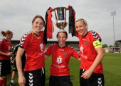 Natasha Cooke Lisa Giampala and Carla Ward of Sheffield FC Ladies celebrate with the trophy during the FA Women's Premier League Cup Final between...