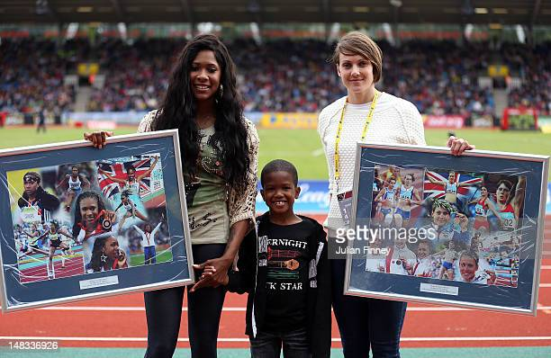 Natasha Danvers and Kelly Sotherton of Great Britain pose for photos after their retirement from the sport during day two of the Aviva London Grand...