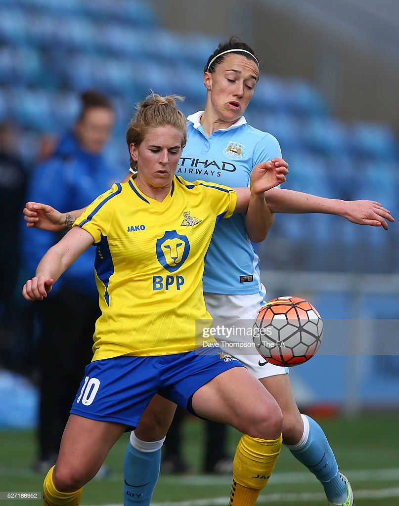 Natasha Dowie of Doncaster Belles and Lucy Bronze of Manchester City Women during the game between Manchester City Women and Doncaster Belles at the Manchester City Academy Stadium on May 2, 2016 in Manchester, England.