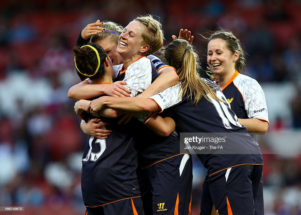 <a gi-track='captionPersonalityLinkClicked' href=/galleries/search?phrase=Natasha+Dowie&family=editorial&specificpeople=4279078 ng-click='$event.stopPropagation()'>Natasha Dowie</a> of Liverpool Ladies celebrates her goal with team mates during the FA WSL Continental Cup match between Arsenal Ladies FC and Liverpool Ladies FC at Emirates Stadium on May 7, 2013 in London, England.