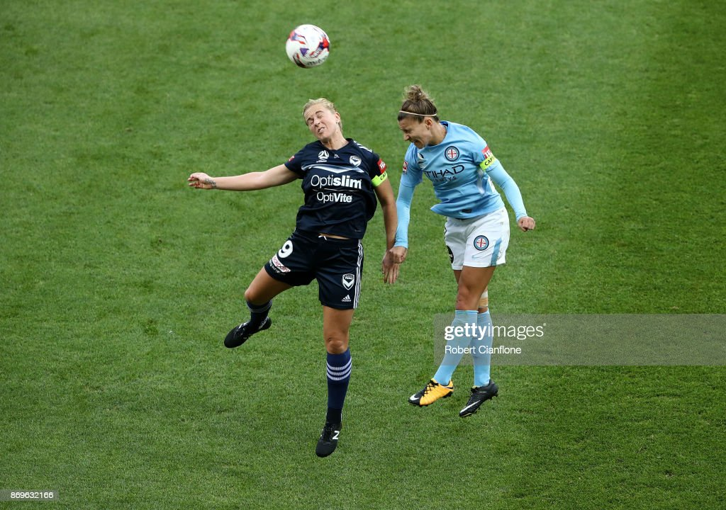 Natasha Dowie of the Victory and Steph Catley of Melbourne City compete for the ball during the round two W-League match between Melbourne City FC and Melbourne Victory at AAMI Park on November 3, 2017 in Melbourne, Australia.