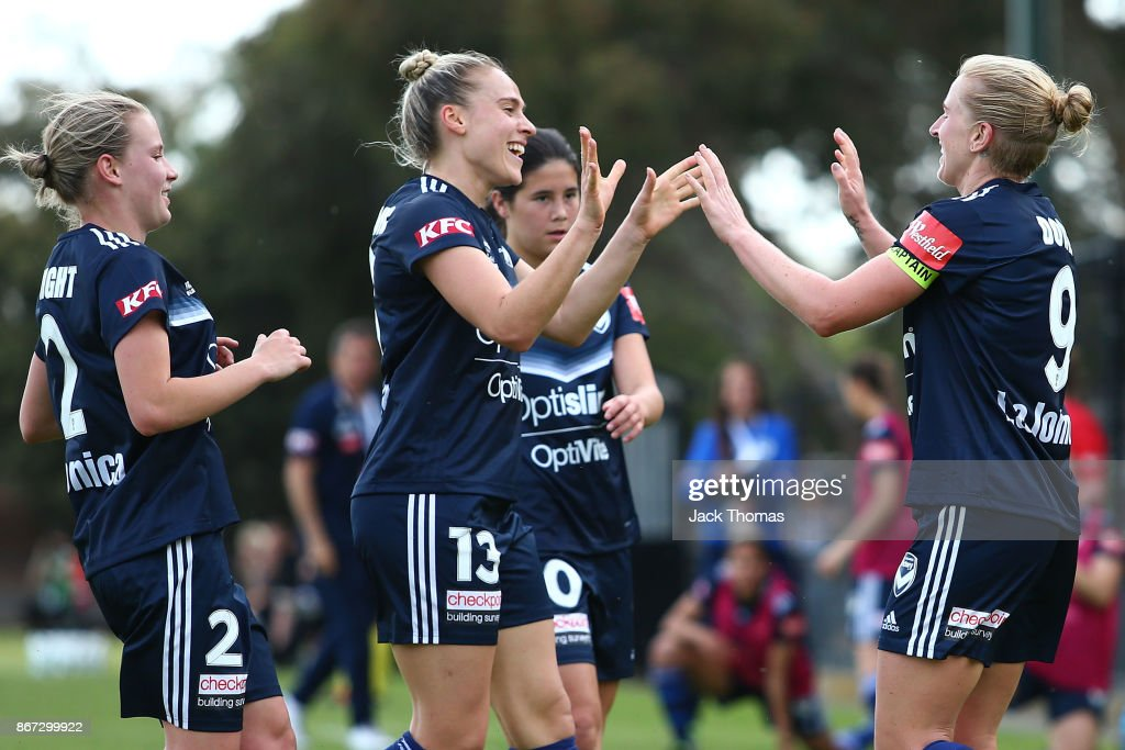 Natasha Dowie of the Victory (R) celebrates a goal with team mates during the round one W-League match between Melbourne Victory and Canberra United at Epping Stadium on October 28, 2017 in Melbourne, Australia.