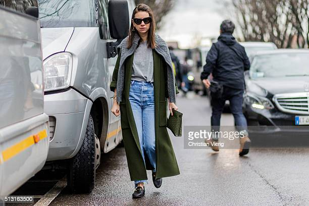Natasha Goldenberg is wearing a grey jumper and shirt green wool coat and blue denim jeans and black Chanel loafers seen outside Giorgio Armani...